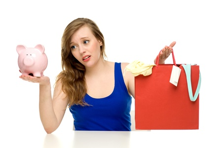 Woman with piggybank and shopping bags  Stock Photo - 13401993