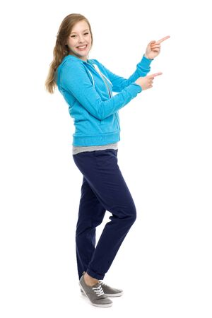 woman pointing up: Attractive woman pointing up Stock Photo