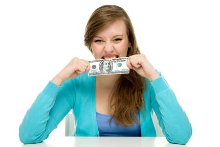 biting: Woman biting dollar bill Stock Photo