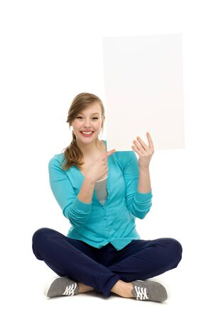 Attractive woman with blank poster Stock Photo - 13682407