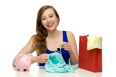 Woman with piggybank and shopping bag photo