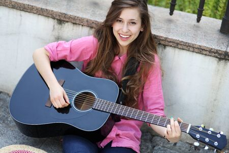 woman guitar: Young woman playing guitar