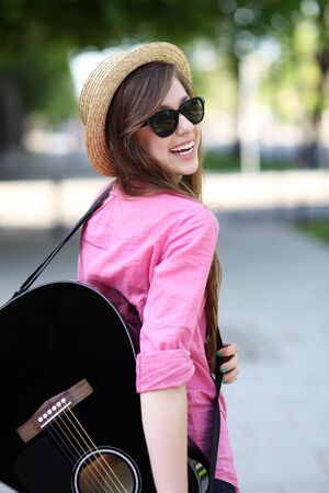 Female with guitar photo