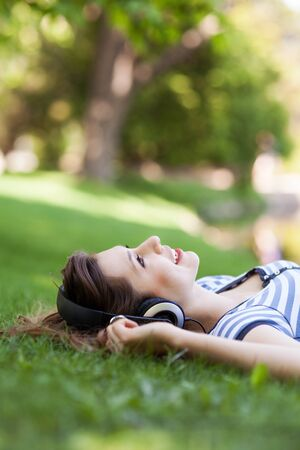 woman lying down: Female lying on grass