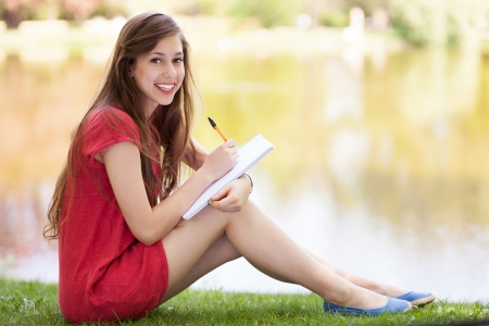 workbook: Female student with workbook outdoors Stock Photo