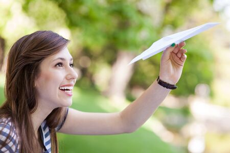 Young woman with paper plane photo