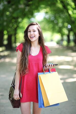 Young woman with shopping bags photo
