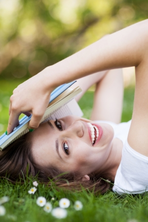Woman lying down with book photo