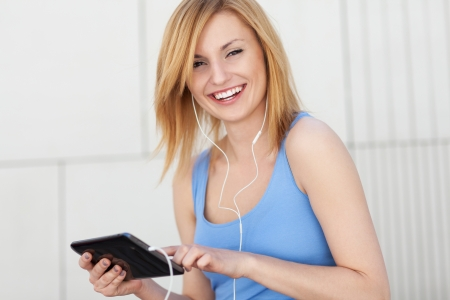 Young woman with digital tablet photo
