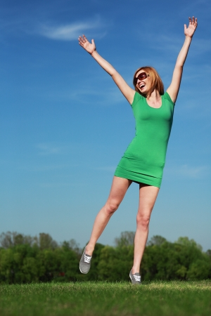 Young woman against blue sky photo