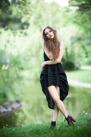 Glamour young woman outdoors photo