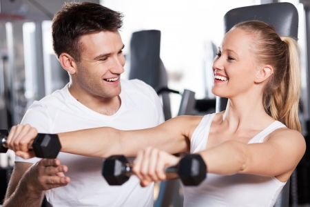 fitness trainer: Woman exercising with personal trainer