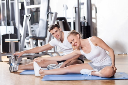 Couple working out at a health club photo