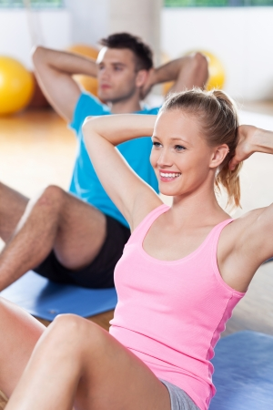 men exercising: Couple working out at a health club