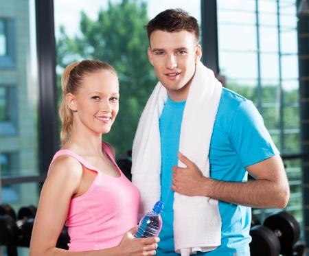 woman towel: Couple in health club