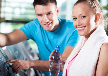 man working out: Couple in health club