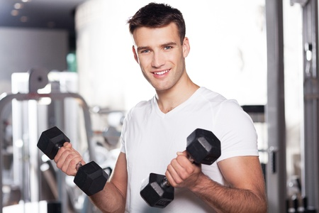 man gym: Man exercising with dumbbells