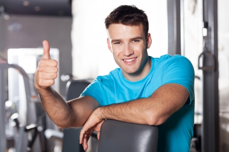 health club: Man in health club showing thumbs up Stock Photo