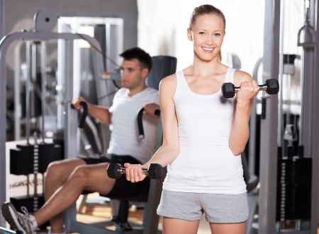 Couple exercising at gym Stock Photo