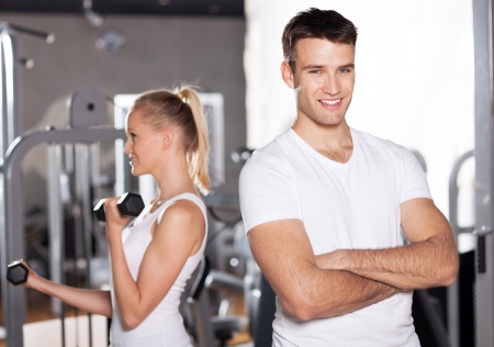 Couple exercising at gym photo