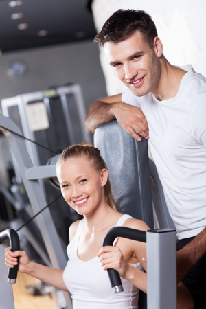 Smiling couple in health club photo