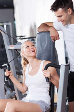 man working out: Smiling couple in health club