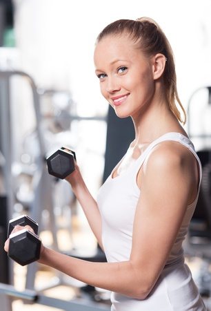 Woman exercising with dumbbells photo