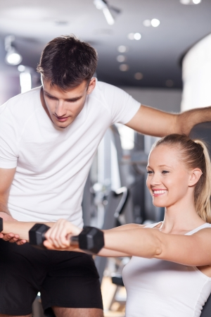 personal trainer: Woman exercising with personal trainer