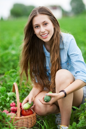 crouching: Woman Picking Fresh Vegetables
