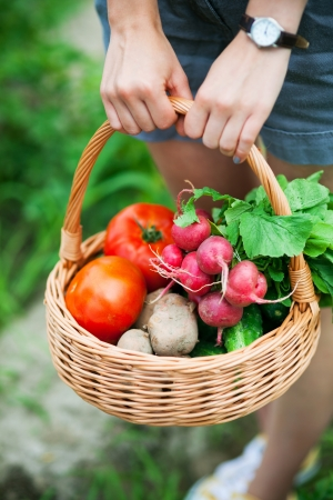 Woman with basket of vegetables photo