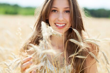 Beautiful woman in the wheat field photo