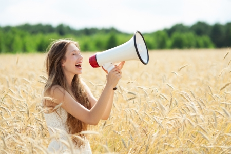 megaphone: Woman with megaphone in the wheat field