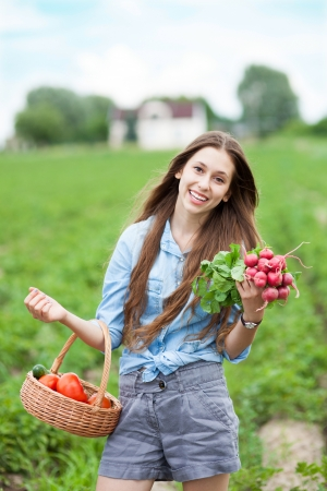 allotment: Woman with basket of harvested vegetables