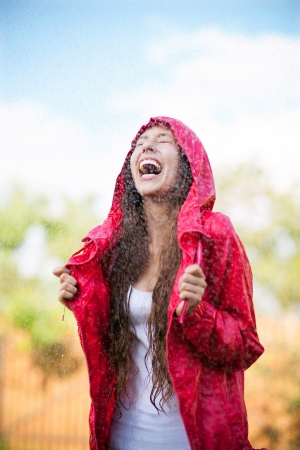 Joyful woman playing in rain photo