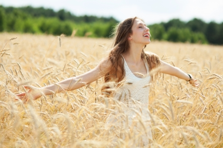 outstretched arms: Woman in the wheat field with arms outstretched
