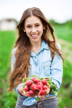 Woman Holding Fresh Radishes photo
