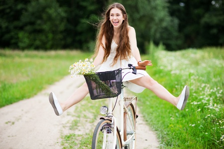 woman bike: Woman riding bicycle with her legs in the air
