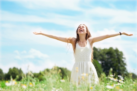 Woman with arms outstretched photo