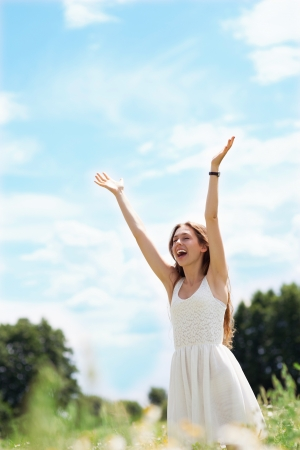 Woman with arms raised  Stock Photo - 14583618