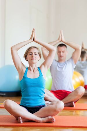 Couple sitting in lotus position  photo