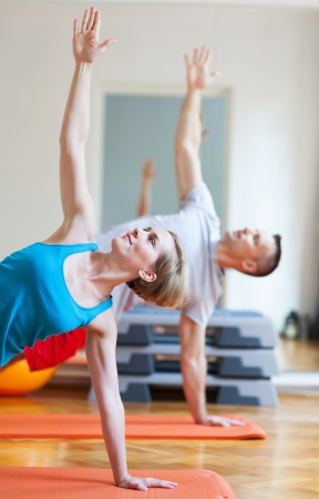 Couple doing yoga  photo