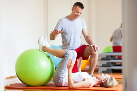 personal trainer: Woman working out with personal trainer