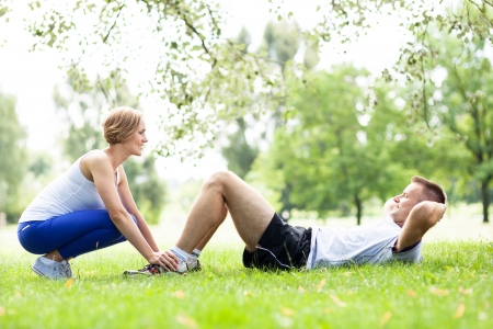 outdoor fitness: Couple Exercising In Park