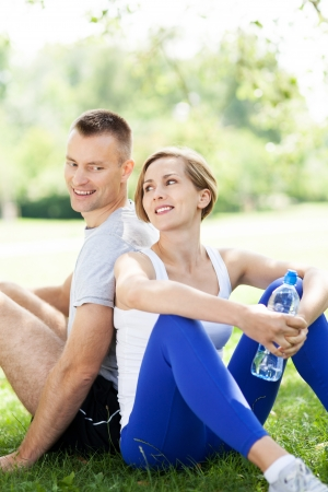 couple exercising: Couple taking a break from exercises