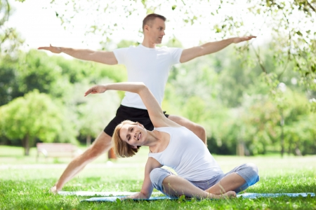 outdoor training: Couple Exercising In Park