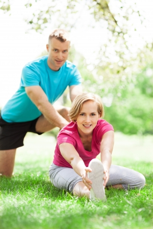 Couple stretching outdoors photo