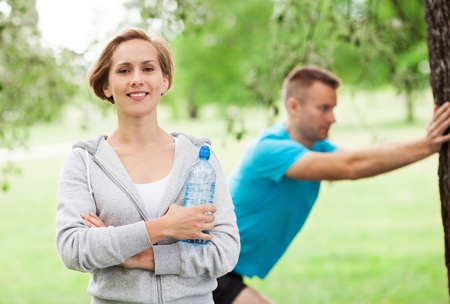 couple exercising: Couple Exercising In Park
