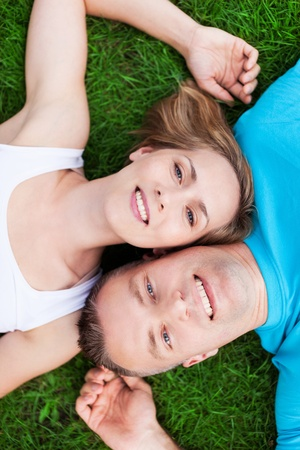 Couple lying together head to head photo