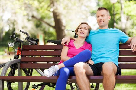 sitting on a bench: Couple on park bench
