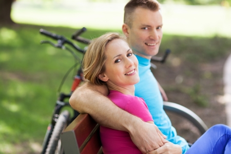 Couple with their bikes in a park photo